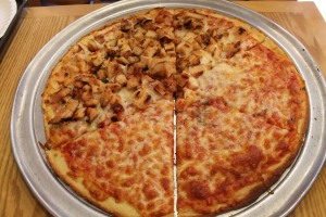 """Half-chicken and half-plain """"personal"""" pizza. Delicious, but way too big."""
