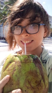 Me drinking out of a coconut on Copacabana beach.