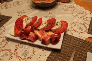 Mozzarella + tomato covered in basil-infused olive oil. Cantaloupe + prosciutto along the bottom.