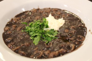 Black bean soup with parsley and heart of palm paste.