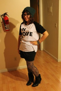 Beanie (Amazon), shirt (ASOS), skirt (UrbanOutfitters), tights (UrbanOutfitters), and boots (MIA)