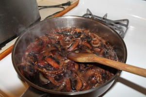 Sauteeing some onions and mushrooms that are about to expire with some oxidated wine.