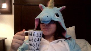 Blue unicorn Kigurumi, looking cozy as ever with a DavidS Tea mug.