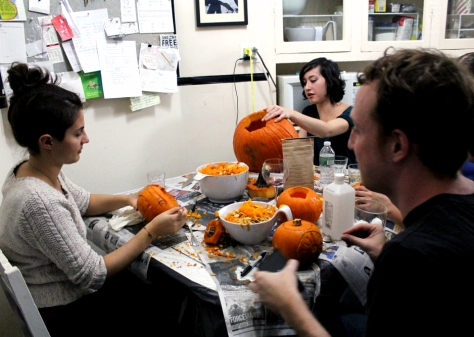 Everyone working hard on their pumpkins.